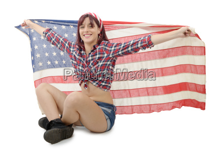 pretty young woman holding an american