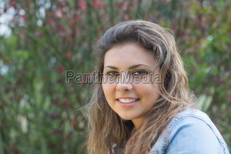 portrait of smiling long hair teenage