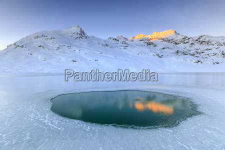 the piz cambrena illuminated by the