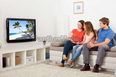 happy family watching television at home