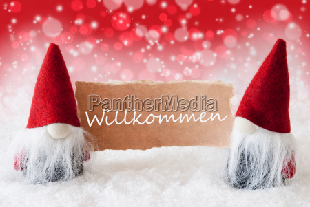 red christmassy gnomes with card willkommen