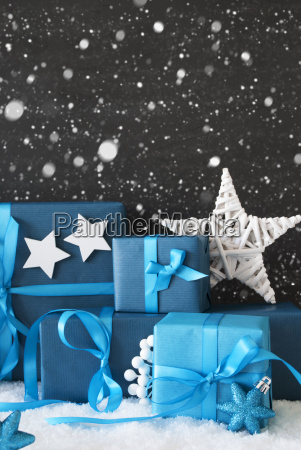 vertical blue christmas gifts black cement
