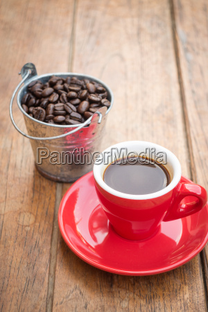 red cup of espresso on wooden