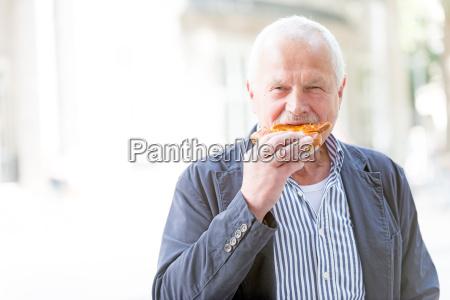 senior with a pretzel