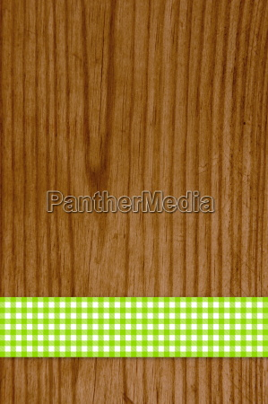 tablecloth green white on wooden background