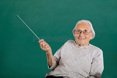 happy female teacher in classroom