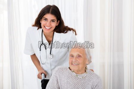 female doctor with handicapped senior patient