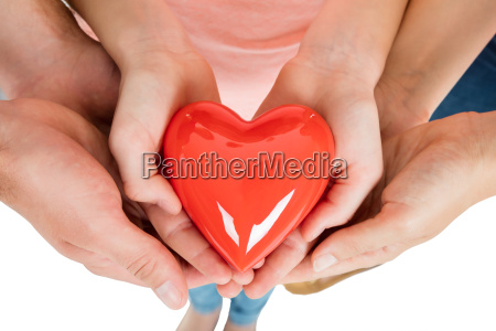 family holding red heart