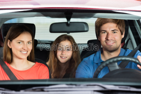 couple driving in car with their