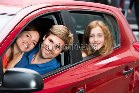 couple sitting in newly purchased car