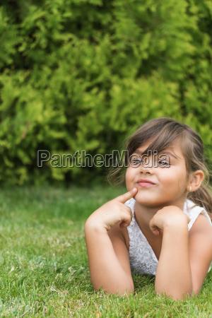 happy little girl is lying on