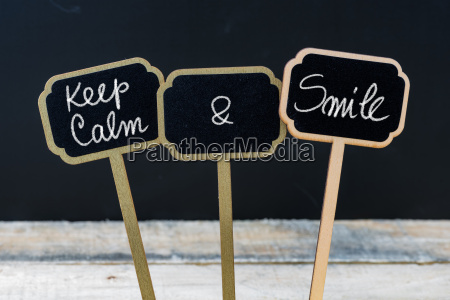 keep calm and smile message written