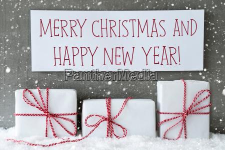 white gift with snowflakes text merry