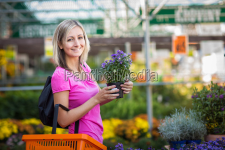 young woman buying flowers at a