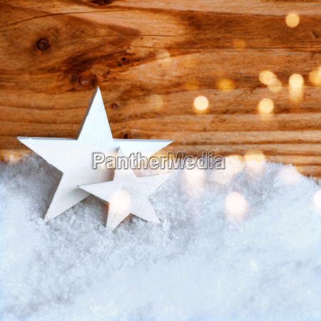 white christmas stars in the snow