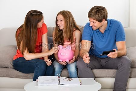 family calculating bills at home