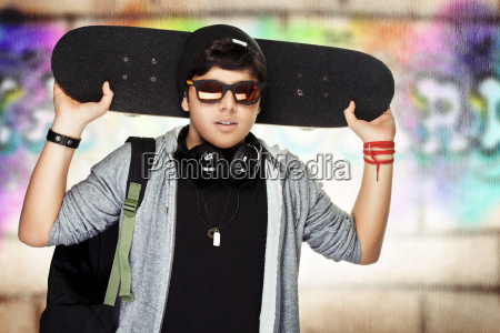 stylish teen boy with skateboard