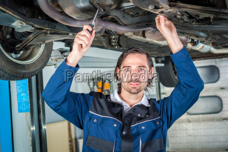 mechanic checking the condition of a