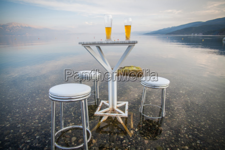 table and chairs by the lake