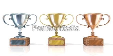 drei cup trophaeen gold silber und