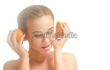 young pretty girl with two oranges
