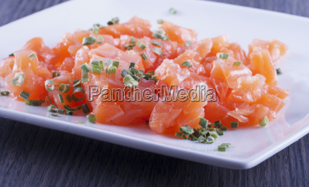 raw salmon over white plate