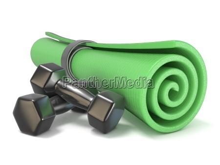 gruene fitness matte und schwarz gewichte