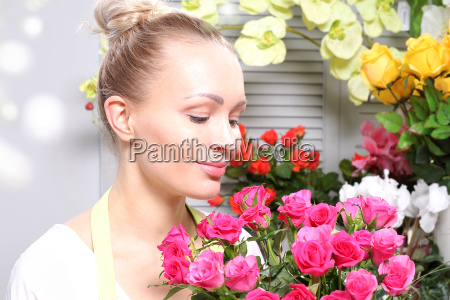 smell the roses woman smelling a