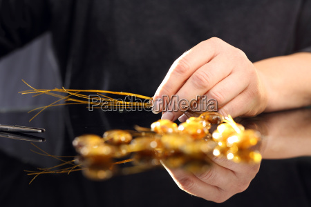 manufactory a woman carries amber jewelry