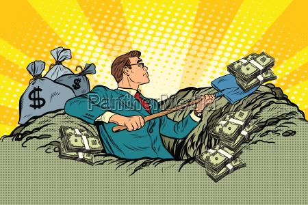 retro geschaeftsmann graebt geld aus dem