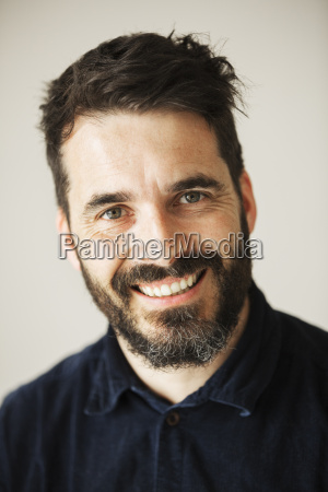 portrait of a bearded man smiling