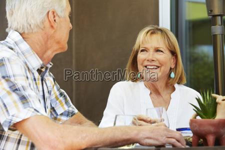 smiling senior woman and man sitting