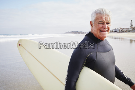 smiling senior man standing on a
