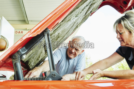 mature woman and senior man repairing