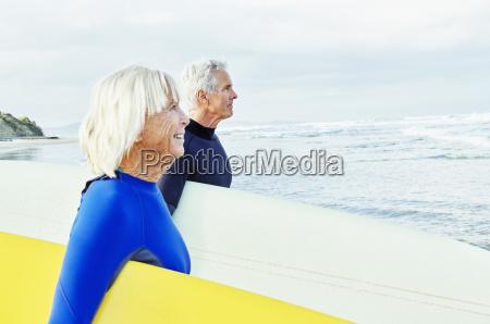 senior woman senior man standing on