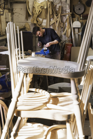 man standing at a work bench