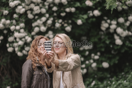 two women taking a selfie with