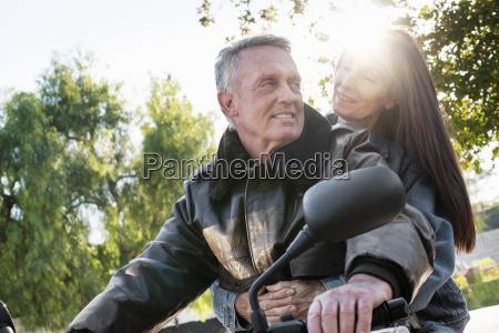 senior couple taking a ride on