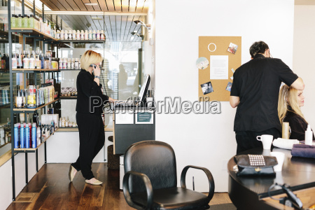 a hair stylist working on a