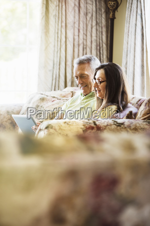 smiling senior couple sitting on a