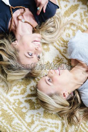 two women lying on their backs