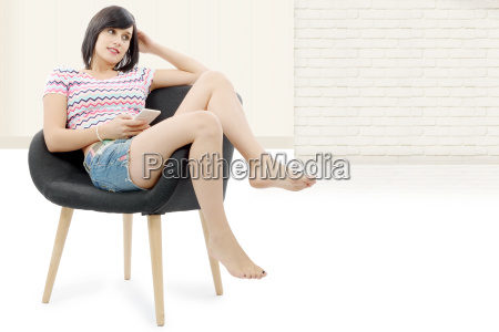 young brunette woman sitting in