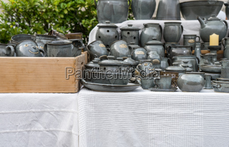 market stand with gray pottery