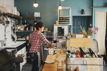 a woman working behind the counter