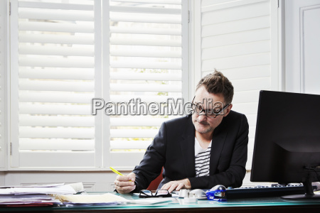 a man sitting at a desk