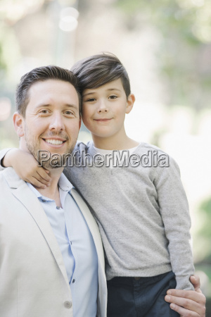 portrait of a smiling father and