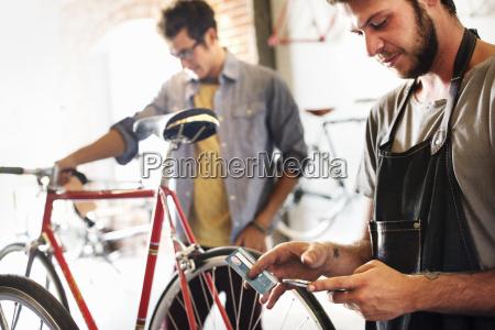 two men in a cycle repair