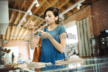 young woman standing in a shop