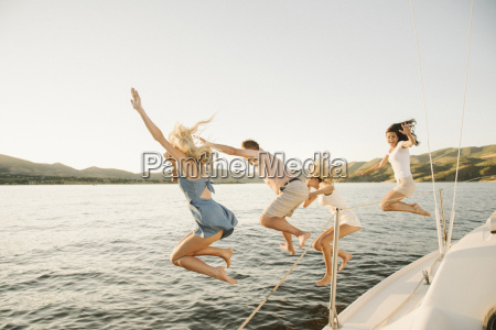 four people jumping off the side