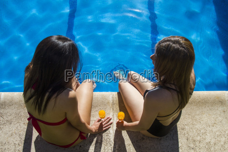 two talking women sitting on the